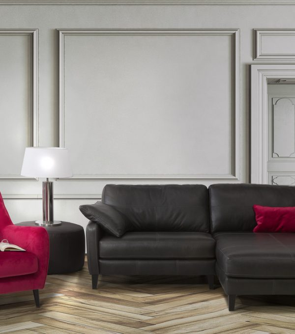 Living room with dark grey sofa and decoration on hardwood floor in front empty wall with copy space. Slight vintage effect applied. 3D rendered image.